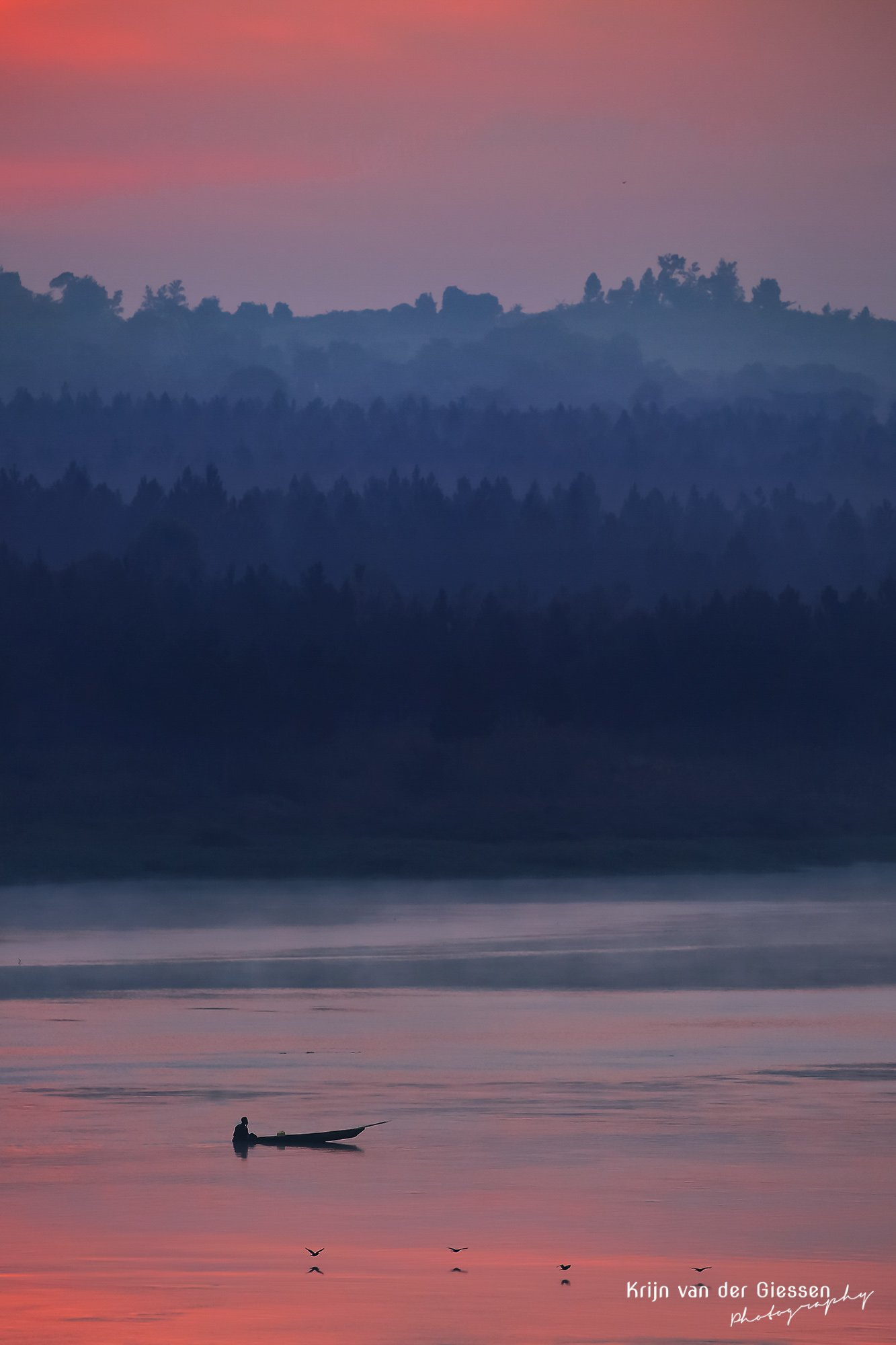 Pastel sunrise over river Nile with fisherman and low flying birds copyright by krijn van der Giessen Photography