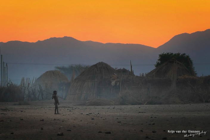Boy in Ethiopian village with speer copyright by krijn van der Giessen Photography