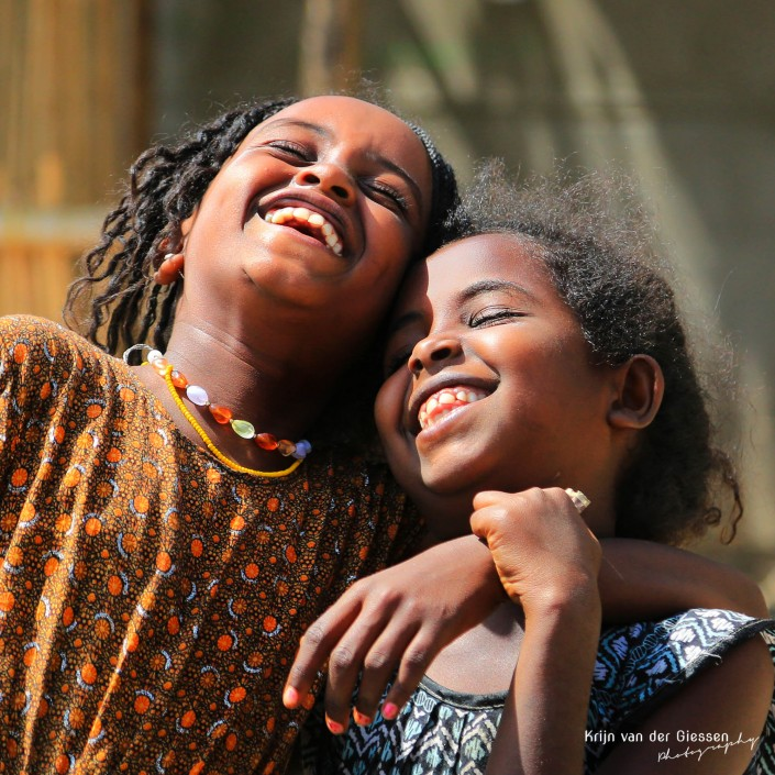 Ethiopian girls laughing copyright by krijn van der Giessen Photography