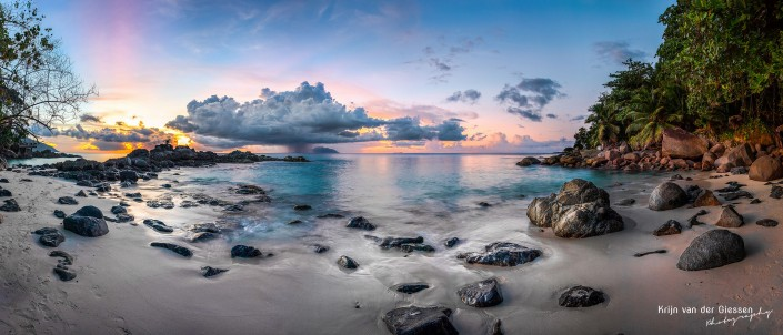 Seychelles panorama tropical beach mahe island rainshower over silhouette island copyright Krijn van der Giessen Photography