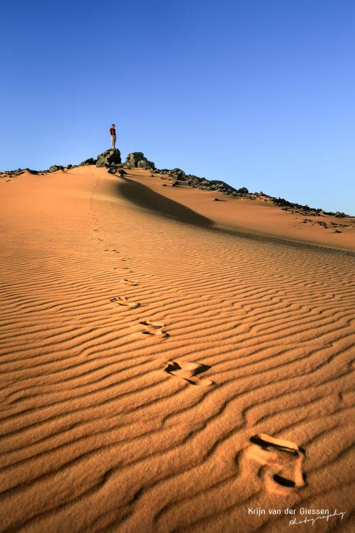 Desert footsteps Sudan copyright by Krijn van der Giessen Photography