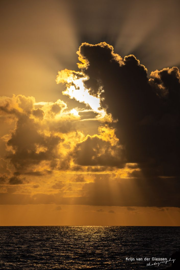 Seychelles epic sunrays through clouds copyright by Krijn van der Giessen Photography