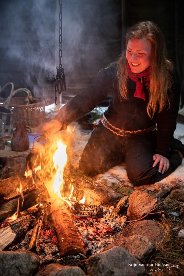 Sami woman boils coffee over open fire copyright by Krijn van der Giessen Photography